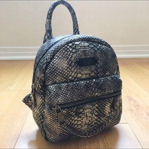 """BCBG silver snakeskin """"MAIN ST"""" mini backpack"""